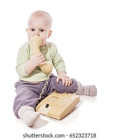 Funny little child talking on the phone isolated on a white