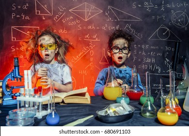 Funny little children doing experiments in the laboratory. Explosion in the laboratory. Science and education.