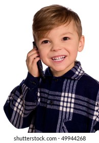 Funny little european boy speaks over cell phone. Beautiful caucasian model. Isolated on white background.