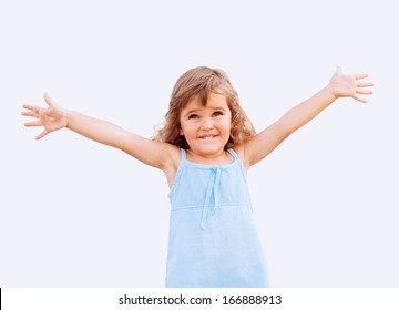 Funny little girl with arms up