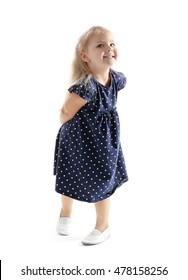 Funny little girl dancing on white background