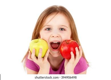 Funny little girl eating apple