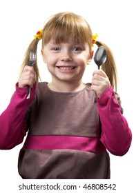 Funny little girl with a fork and a spoon over white background