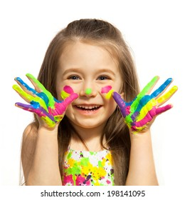 Funny little girl with hands painted in colorful paint. Isolated on white background.