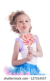Funny little girl with lollipop
