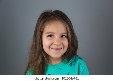 Funny little girl looks happy and upbeat