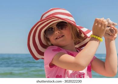 Funny little girl  on the beach.