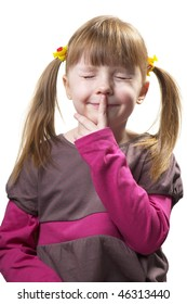 Funny little girl with plaits and closed eyes keeping her secret (over white)