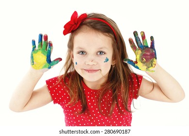 Funny little girl playing with watercolors