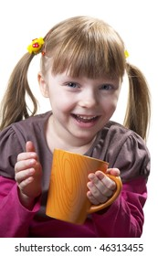 Funny little girl with tea cup isolated over white background