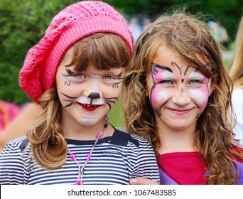 Funny little girls with painted face