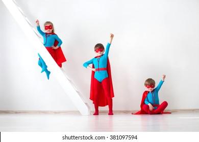 Funny little Kids power super hero. Superhero concept. Kids characters in costumes superheroes posing. Idea.