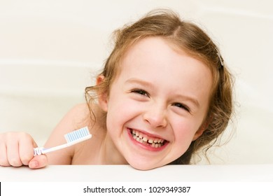 Funny little school girl lost her milk tooth