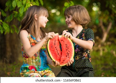 Funny little sisters girl eat watermelon in summer. Healthy eating concept