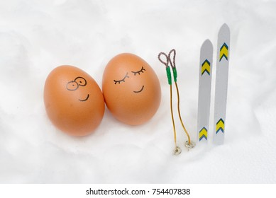 Funny lovely eggs with ski in snow.