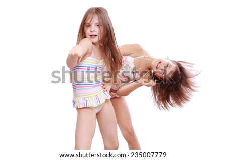 1ac51dd9202e5 funny lovely little girls wearing swimsuits and posing on camera as a models