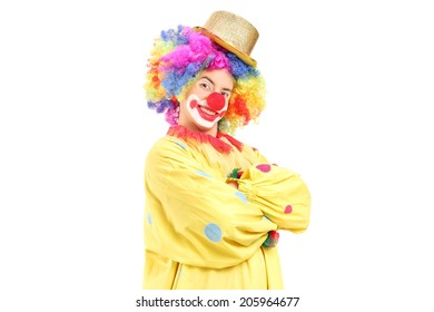 Funny male clown in a yellow costume isolated on white background