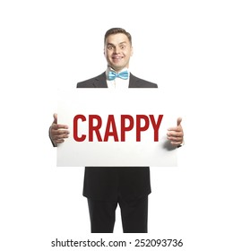 Funny man in blue bow tie holding a plate with title 'crappy'