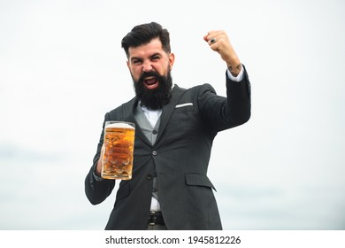 Funny man in classical suit holding glass with beer in hand. Excited man with beer. Bartender brewer with expression emotions