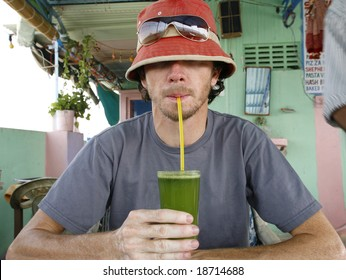 Funny man drinking fresh mint and lemon juice