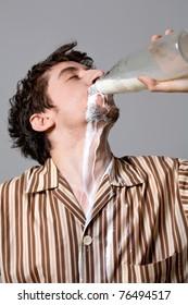 Funny man drinking milk carelessly