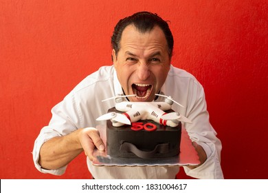 funny man eating a 50 years cake