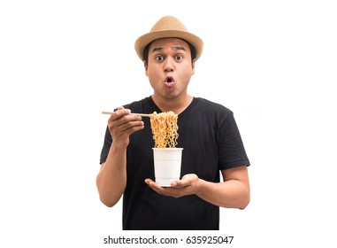 Funny man eating instant noodles