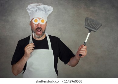 funny man with fried eggs in his eyes on gray background