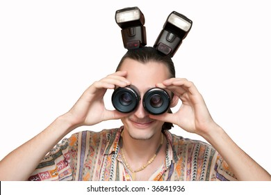 Funny man with horns made from flashlights  is looking into to similar lenses using them as a binocular. Isolated on white.