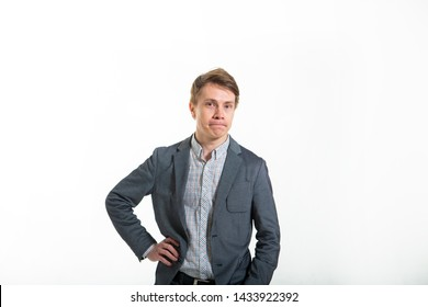 Funny man in a jacket, on a white background. Smart guy with a funny facial expression. Biznismen humor