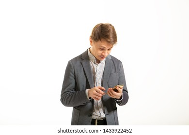Funny man in a jacket, on a white background. Smart guy with a funny facial expression. Busy businessman humor makes selfie