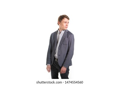 Funny man in a jacket, on a white background. Smart guy with a funny facial expression. Biznisman humor shows hand