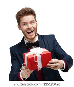 Funny man passes a gift wrapped in red packaging, isolated on white