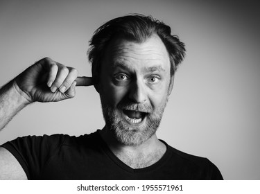 Funny man portrait in black and white technique. Balck and white photography