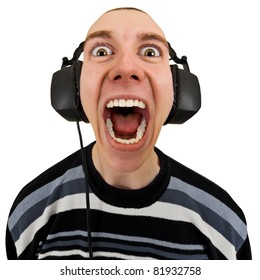 Funny man in the stereo headphones shouting isolated on a white background