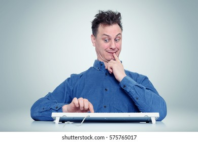 Funny man thinks click on the enter button or not. Indecisive programmer
