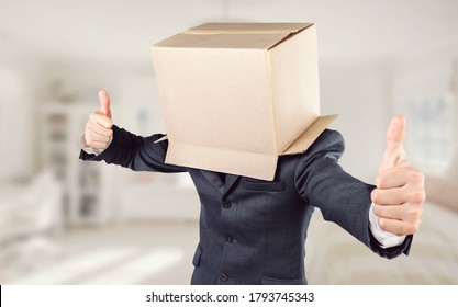 Funny man wearing cardboard box on his head