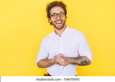 Funny man wearing pink shirt and glasses.