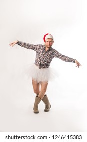 Funny man wearing a tutu and boots, dancing
