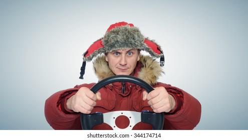 Funny man winter driving, car drive concept