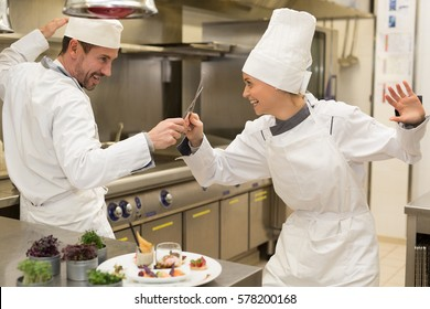 funny match in kitchen between chefs
