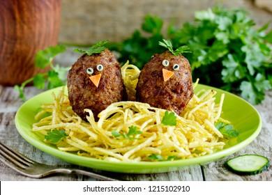 Funny meatballs for kids birds in nest with fried potato straws