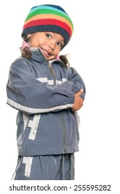 Funny mixed race little girl wearing a colorful beanie hat and a jacket with an attitude isolated on white