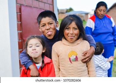 Funny native american children showing tongue.
