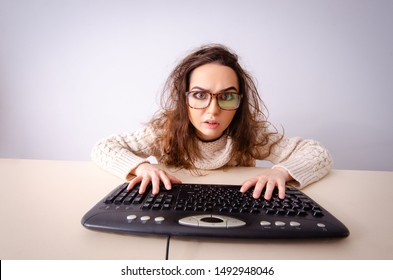 Funny nerd girl working on computer