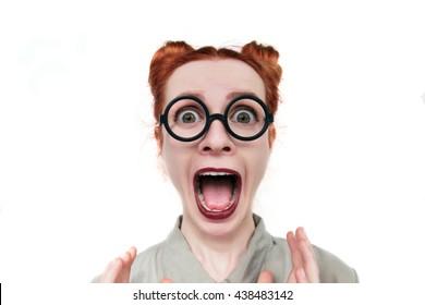 Funny nerdy redhead girl. Beautiful redhead girl in glasses. saucer eyes. bulging eyes