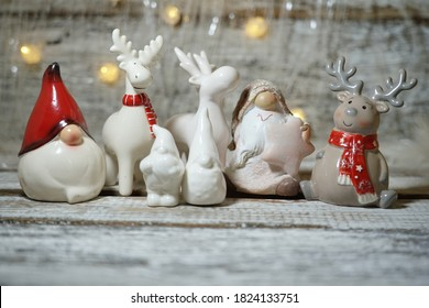 Funny  Nicholas  and reindeer in lights lamps in a winter scenery.  Christmas decoration - The magic of Christmas