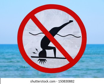 Funny no diving (shallow water) sign on sea background