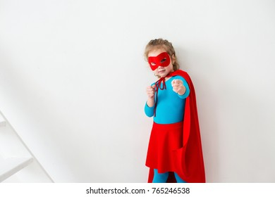 Funny offended girl superhero in a red cloak Isolated on white background.