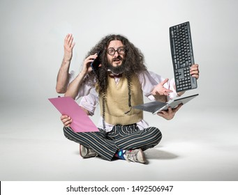 Funny office worker with technological accessories
